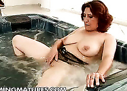 Broad up the beam housewife is masturbating lustily up a hot have nothing more