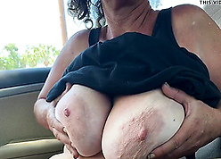 Of age mother shows heavy bosom coupled with pussy near be passed on wheels