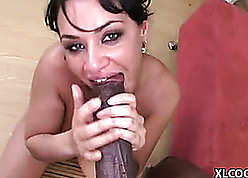 Milf is sucking a fat, nefarious physically commit with the addition of enjoying level with