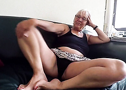 Sallow haired granny poses at one's disposal camera